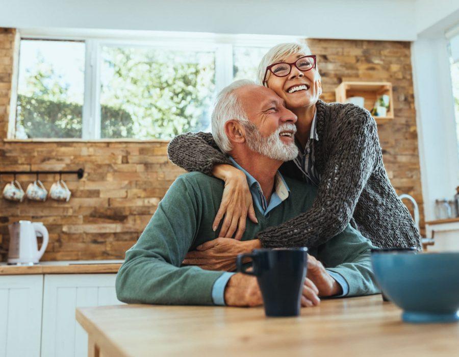 Shot of a mature woman hugging her husband
